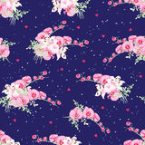 Navy dotted pattern with orchid and lily bouquets Royalty Free Stock Image