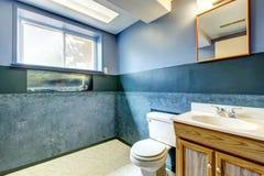 Navy empty bathroom Stock Photo