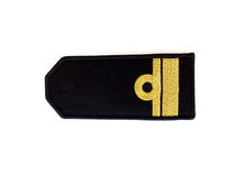 Navy epaulet. Close up of the black navy epaulet with gold trim Stock Image
