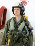 Navy fighter pilot. U.S. Navy Fighter pilot in full gear by his jet Royalty Free Stock Image