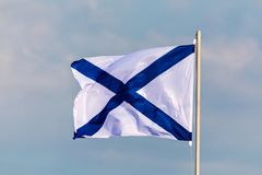 The Navy flag or ensign of Russian Federation on the background of cloudy sky in the wind weather. The flag of St. Andrew called this way in honour apostle royalty free stock photos