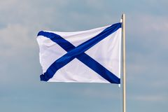 The Navy flag or ensign of Russian Federation on the background of cloudy sky in the wind weather. The flag of St. Andrew called this way in honour apostle stock photos