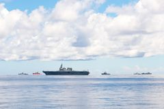 Navy fleet including JS Ise, helicopter destroyer of Japan Maritime Self-Defense Force and other warships and commercial ships royalty free stock images