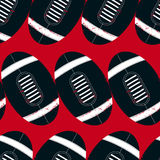 Navy footballs seamless pattern on a red background Royalty Free Stock Photos
