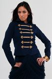 Navy jacket. Pretty young Asian woman in a navy jacket and skirt Stock Photography