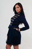 Navy jacket. Pretty young Asian woman in a navy jacket and skirt Royalty Free Stock Image
