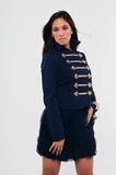 Navy jacket. Pretty young Asian woman in a navy jacket and skirt Royalty Free Stock Photography