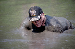 Navy man in the mud stock photos