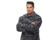 Navy man posing against white Stock Image