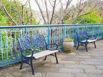 Navy metal bench in the glover garden Royalty Free Stock Image