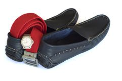 Navy mocassins with red belt and silver watch Royalty Free Stock Image