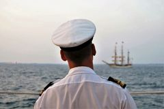 Navy officer watching the tall ship at the Tagus river Royalty Free Stock Photography