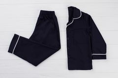 Navy pajama set on white. Background. Shirt and pants. Classic style sleepwear for growing boys Stock Images