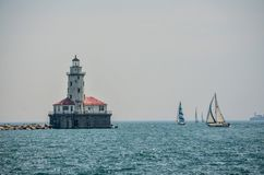 Navy Pier Lighthouse. A view of Navy Pier Lighthouse from out on Lake Michigan stock photo