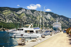 Navy Pier with yachts and cruise liners in the town of Kotor Royalty Free Stock Photos