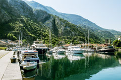 Navy Pier with yachts  in the town of Kotor Royalty Free Stock Images
