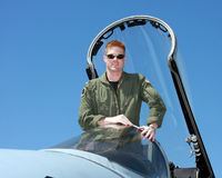 Navy pilot. Standing in the cockpit of a F-18  fighter jet Royalty Free Stock Photography