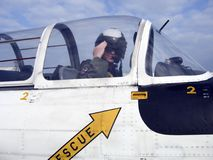 Navy Pilot giving a salute in a jet. Navy Pilot giving a salute from insife of his Jet royalty free stock photo