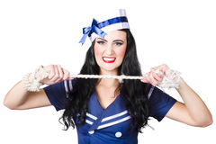 Navy pin up poster girl breaking rope Stock Photography