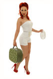 Navy pinup with suitcase. Picture of beautiful sexy retro navy woman holding suitcase Stock Image