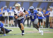 NAVY Quarterback  Zach Abey runs the ball. NAVY Quarterback Zach Abey is chased my Memphis Tigers Linebacker, GENARD AVERY 6 during an NCAA football game at Stock Images