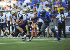 NAVY Quarterback  Zach Abey runs the ball. NAVY Quarterback Zach Abey runs the ball and is met by Tigers defensive lineman JACOBY HILL 52 during an NCAA football Stock Photography