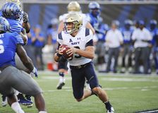 NAVY Quarterback  Zach Abey runs the ball. NAVY Quarterback Zach Abey runs the ball during an NCAA football game against the Memphis Tigers at Liberty Bowl Royalty Free Stock Image