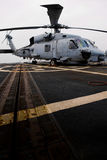 Navy rescue helicopter. Photo of a navy rescue helicopter on board the flight deck of a US Destroyer at sea Royalty Free Stock Photography