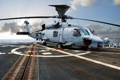 Navy Rescue Helicopter. US Navy Rescue Helicopter deployed on board USS Chafee DDG 90. Military transportation on the flight deck of a ship at sea Stock Photos