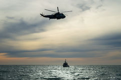 Navy rescue helicopter. Flying over the sea Stock Image