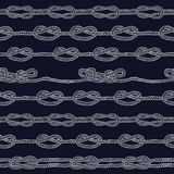 Navy rope and marine knots striped seamless pattern. Stock Image