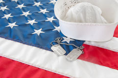 Navy sailor cover. United states navy hat and dog tags Stock Photo