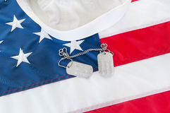 Navy sailor hat. And dog tags Royalty Free Stock Photography