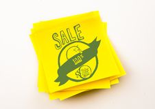 Navy sale doodle against yellow sticky note Stock Photos