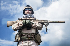 Navy SEAL in action. Member of Navy SEAL Team with weapons in action Royalty Free Stock Photos