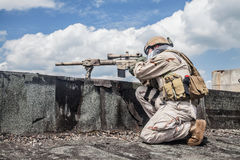 Navy SEAL in action. Member of Navy SEAL Team with weapons in action Stock Images