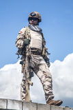 Navy SEAL in action. Member of Navy SEAL Team with weapons in action Stock Photo