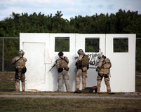 Navy SEAL - Assault Demo at UDT-SEAL Museum. Military reserve members of SEAL Team Eighteen prepare to conduct a mock doorway breach and assault of a building Royalty Free Stock Image