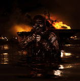 Navy SEAL frogman. With complete diving gear and weapons royalty free stock photo