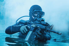 Navy SEAL frogman. With complete diving gear and weapons in the water stock image