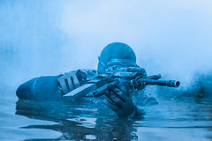 Navy SEAL frogman. With complete diving gear and weapons in the water royalty free stock photos