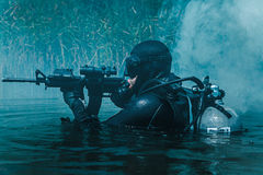 Navy SEAL frogman. With complete diving gear and weapons in the water Stock Photography