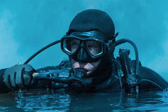 Navy SEAL frogman. With complete diving gear and weapons in the water Royalty Free Stock Photography