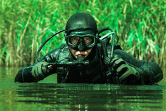 Navy SEAL frogman. With complete diving gear and weapons in the water stock photo