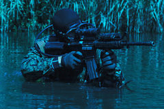 Navy SEAL frogman. With complete diving gear and weapons in the water Stock Photos