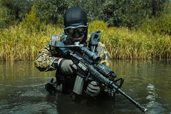 Navy SEAL frogman. With complete diving gear and weapons in the water royalty free stock image