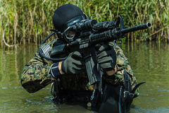 Navy SEAL frogman. With complete diving gear and weapons in the water royalty free stock photo