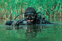 Navy SEAL frogman. With complete diving gear and weapons in the water stock images