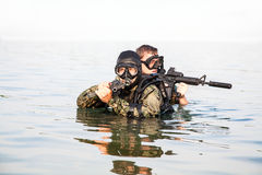 Navy SEAL frogmen. With complete diving gear and weapons in the water royalty free stock image