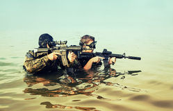 Navy SEAL frogmen. With complete diving gear and weapons in the water Stock Images